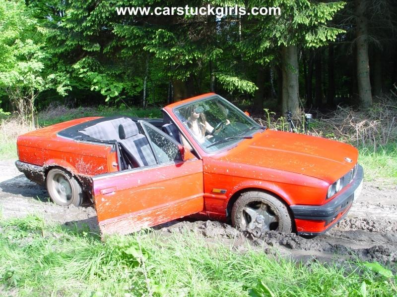 Kim's BMW Convertiblegot stuck in the mud