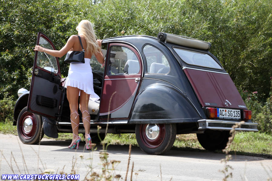 sexy hot blonde stuck in mud with citroen 2cv ente. Black Bedroom Furniture Sets. Home Design Ideas