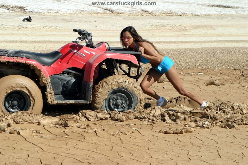 quad atv girl mud stuck
