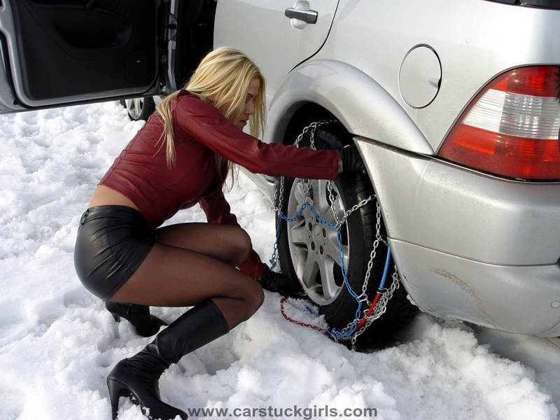 Sexy leather girl stuck with snow chains