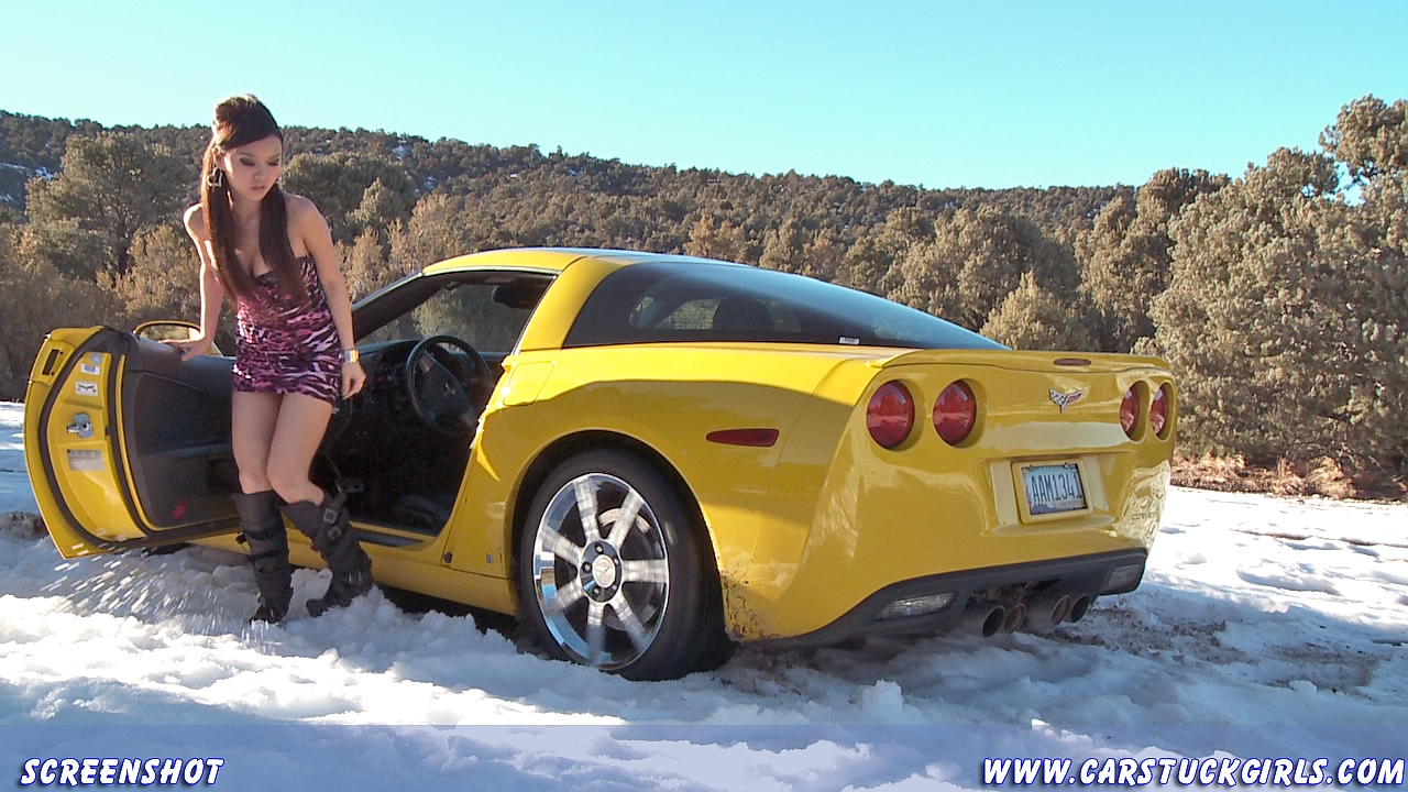 screaming tires hot asian girl stuck in snow in a great v8 sports car. Black Bedroom Furniture Sets. Home Design Ideas